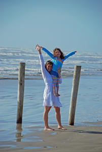 mom and daughter on beach in galveston tx
