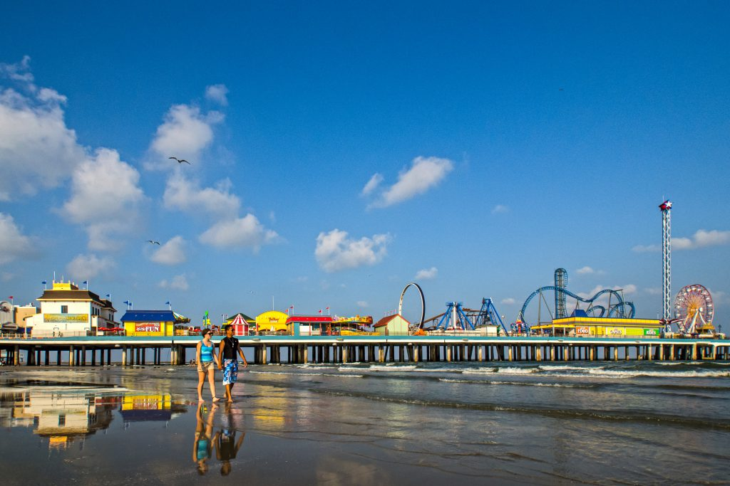 Couple on Beach at Galveston Island Pleasure Pier