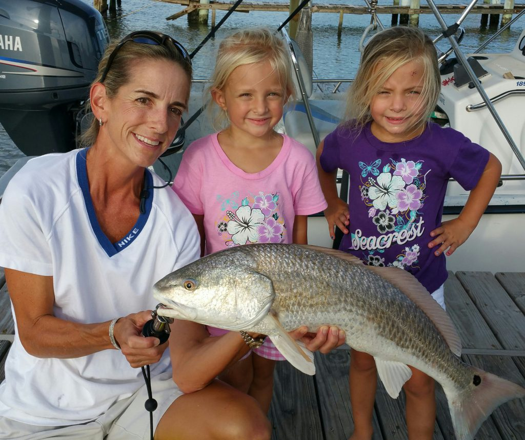 Mother & Daughters with Fish on Galveston Island