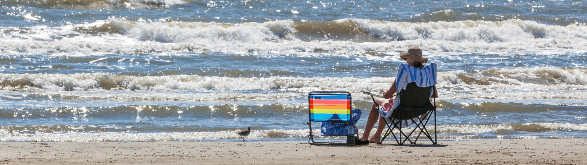 Woman relaxing on the beach in Galveston TX.