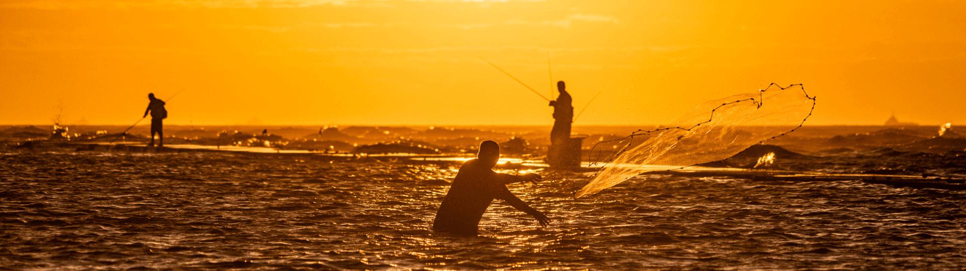 Fishing at sunset in Galveston tx