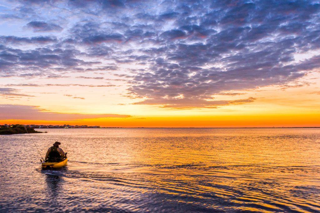 Man Kayaking at Sunset on Galveston Bay