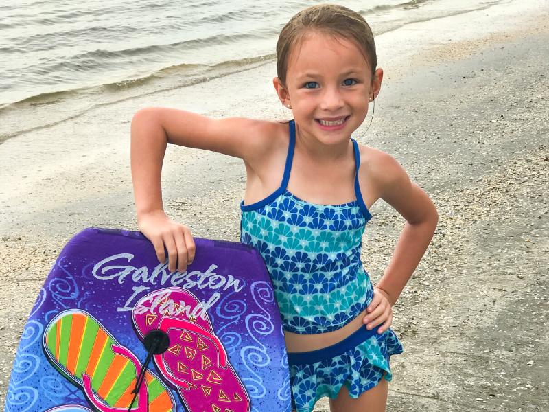 Girl with Galveston Island boogie board