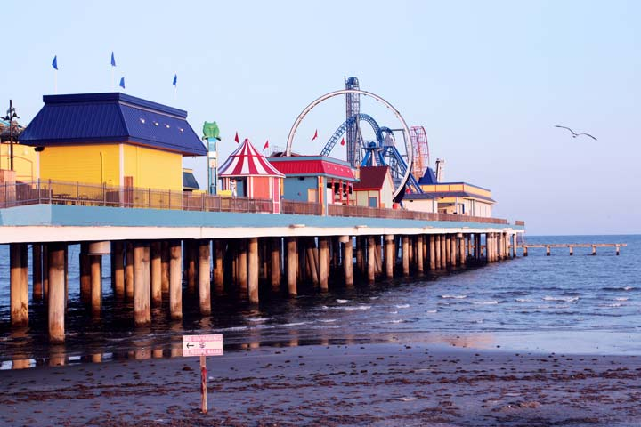 Beach pier with colorful rides and attractions.