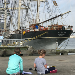 homeschool brother and sister looking at the Tall ELISSA ship in Galveston